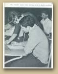 Mrs. Stauffer Assists A student with an algebra problem